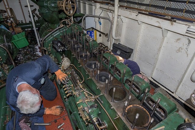 Volunteers stripping down the engine